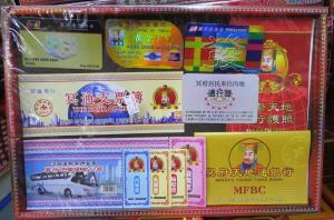 Modern joss paper (ghost cash, cheque books, travel tickets, passport and credit cards)