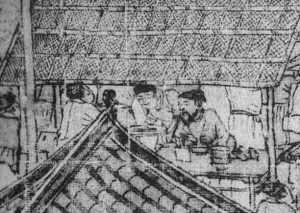 A tea house with a well dressed customer and a waiter serving him