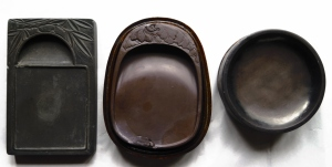 Ink stones of different shapes. Most artists prefer using the round one as the ink can accumulate in the middle.